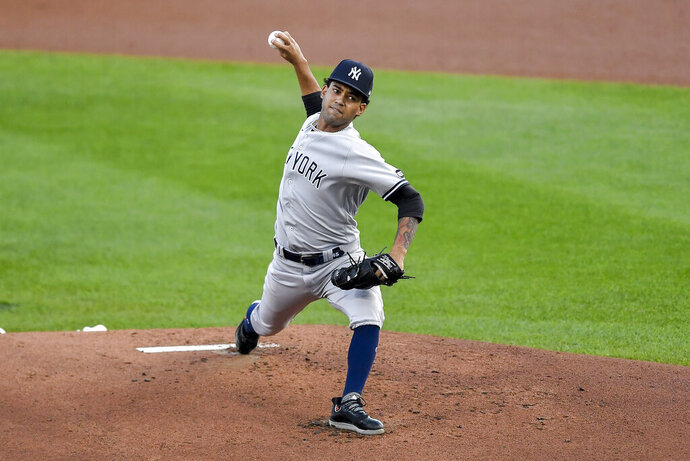 New York Yankees starting pitcher Deivi Garcia throws to a Toronto Blue Jays batter during the first inning of a baseball game in Buffalo, N.Y., Wednesday, Sept. 9, 2020. (AP Photo/Adrian Kraus)
