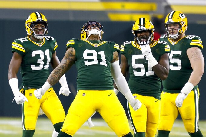 Green Bay Packers' Preston Smith reacts after sacking Carolina Panthers' Teddy Bridgewater during the first half of an NFL football game Saturday, Dec. 19, 2020, in Green Bay, Wis. (AP Photo/Matt Ludtke)