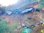A landslide damages houses in a village in Phuoc Loc district, Quang Nam province, Vietnam Thursday, Oct. 29, 2020. Three separated landslides triggered by Typhoon Molave killed more than a dozen villagers in the province as rescuers scramble to recover more victims. (Lai Minh Dong/VNA via AP)