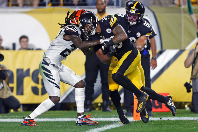 Pittsburgh Steelers running back James Conner (30) scores with Cincinnati Bengals cornerback Dre Kirkpatrick (27) defending during the first half of an NFL football game in Pittsburgh, Monday, Sept. 30, 2019. (AP Photo/Tom Puskar)