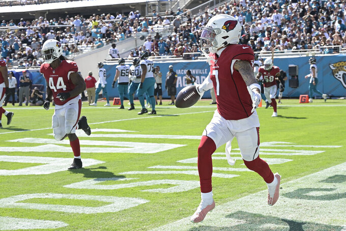 Arizona Cardinals cornerback Byron Murphy (7) celebrates his touchdown against the Jacksonville Jaguars on an intercepted pass during the second half of an NFL football game, Sunday, Sept. 26, 2021, in Jacksonville, Fla. (AP Photo/Phelan M. Ebenhack)