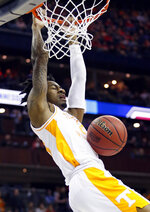 Tennessee's Jordan Bowden dunks the ball against Colgate in the first half of a first-round game in the NCAA men's college basketball tournament in Columbus, Ohio, Friday, March 22, 2019. (AP Photo/Paul Vernon)