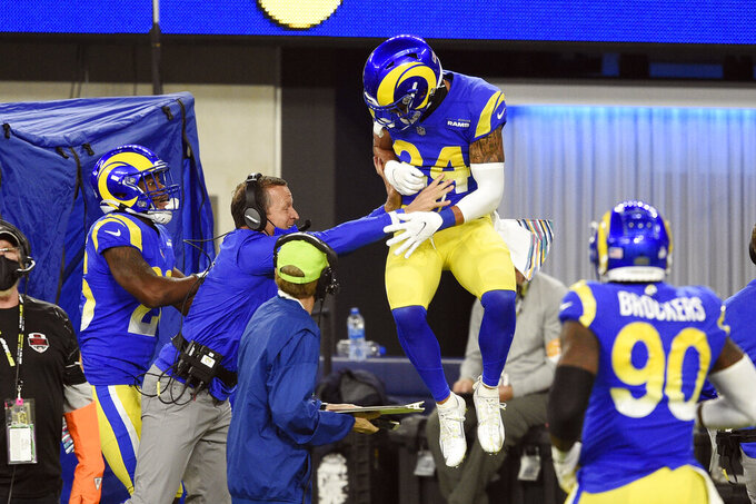 Los Angeles Rams safety Taylor Rapp, center, celebrates with coaches and teammates after intercepting a pass in the end zone during the second half of an NFL football game against the Chicago Bears Monday, Oct. 26, 2020, in Inglewood, Calif. (AP Photo/Kelvin Kuo)