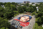FILE - In this July 6, 2020, file photo a ground mural depicting a portrait of Breonna Taylor is seen at Chambers Park, Monday, July 6, 2020, in Annapolis, Md. Americans' suggestions of suitable statuesfor President Donald Trump's planned National Garden of American Heroes are in, and they look considerably different from the predominantly white worthies that the administration has locked in for many of the pedestals. Lehigh County, Pennsylvania Commissioner Amy Zanelli, suggested George Floyd, Breonna Taylor, and other Black Americans whose killings by police sparked massive street protests. (AP Photo/Julio Cortez, File)
