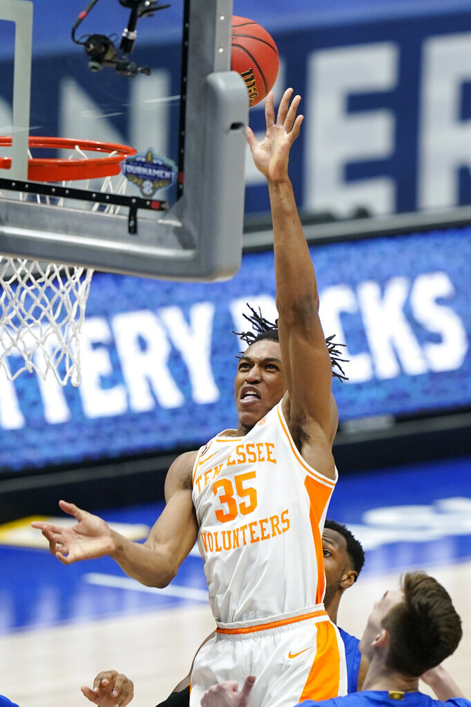 Tennessee's Yves Pons (35) scores against Florida in the second half of an NCAA college basketball game in the Southeastern Conference Tournament Friday, March 12, 2021, in Nashville, Tenn. (AP Photo/Mark Humphrey)