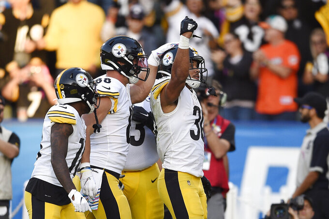 Pittsburgh Steelers running back James Conner, right, celebrates a touchdown with teammates during the first half of an NFL football game against the Los Angeles Chargers, Sunday, Oct. 13, 2019, in Carson, Calif. (AP Photo/Kelvin Kuo)