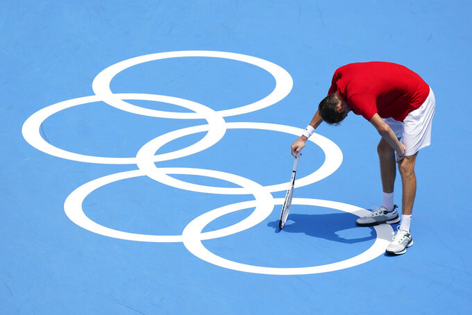 Daniil Medvedev, of the Russian Olympic Committee, pauses during a third round men's tennis match against Fabio Fognini, of Italy, at the 2020 Summer Olympics, Wednesday, July 28, 2021, in Tokyo, Japan. (AP Photo/Patrick Semansky)