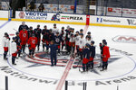 Columbus Blue Jackets players gather at center ice during NHL hockey practice Tuesday, Jan. 5, 2021, in Columbus, Ohio. (AP Photo/Jay LaPrete)