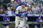 Los Angeles Dodgers' Trea Turner breaks from the batter's box after singling against Colorado Rockies starting pitcher German Marquez In the first inning of a baseball game Wednesday, Sept. 22, 2021, in Denver. (AP Photo/David Zalubowski)