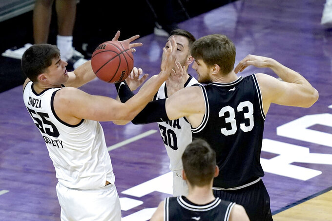 Iowa's Luka Garza (55) and teammate Gabe McGlothan (30) battle Grand Canyon's Asbjorn Midtgaard for a rebound during the first half of a first round NCAA college basketball tournament game Saturday, March 20, 2021, at the Indiana Farmers Coliseum in Indianapolis. (AP Photo/Charles Rex Arbogast)