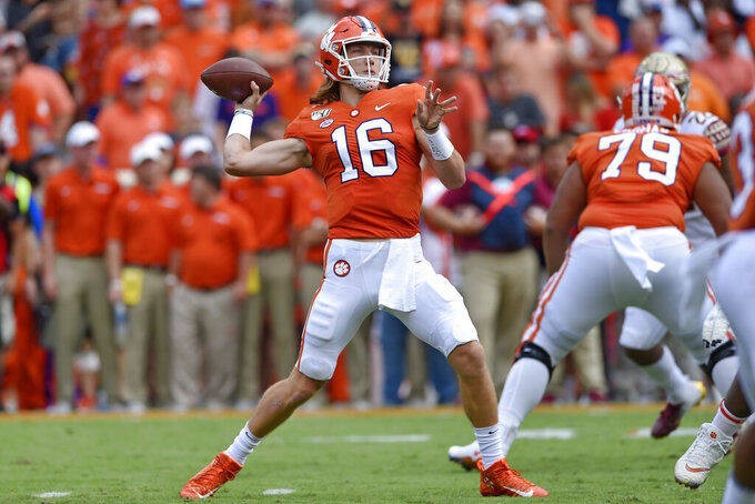 Clemson quarterback Trevor Lawrence drops back to pass during the first half of an NCAA college football game against Florida State Saturday, Oct. 12, 2019, in Clemson, S.C. (AP Photo/Richard Shiro)