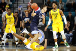 Baylor guard Mark Vital falls to the floor guarding Villanova forward Cole Swider (10) during the first half of an NCAA college basketball championship game at the Myrtle Beach Invitational in Conway, S.C., Sunday, Nov. 24, 2019. (AP Photo/Gerry Broome)