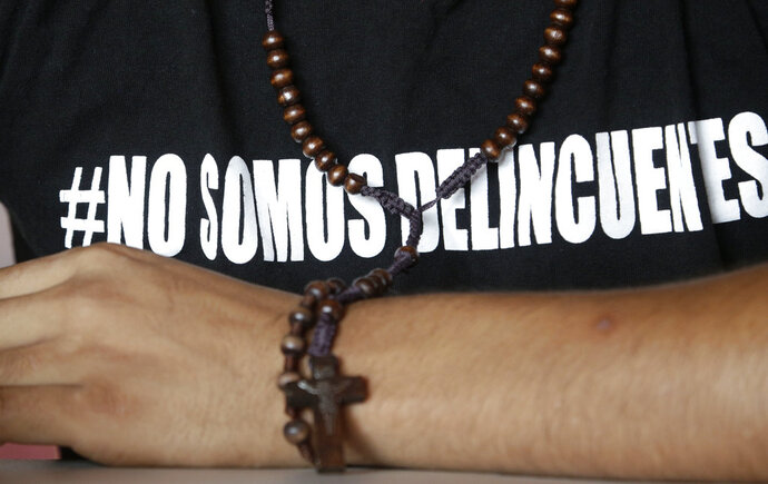 In this Saturday, July 28, 2018 photo, Jairo Bonilla, leader of the April 19 student movement, wears a T-shirt with text that reads in Spanish