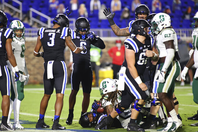 Duke wide receiver Jontavis Robertson (1) lies on the bottom of the pile after scoring a touchdown against Charlotte during the first half of an NCAA college football game Saturday, Oct. 31, 2020, in Durham, N.C. (Jaylynn Nash/Pool Photo via AP)