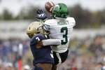Tulane wide receiver Darnell Mooney, right, goes up to catch a touchdown pass from quarterback Justin McMillan, not visible, as Navy cornerback Cameron Kinley tries to defend during the first half of an NCAA college football game, Saturday, Oct. 26, 2019, in Annapolis. (AP Photo/Julio Cortez)
