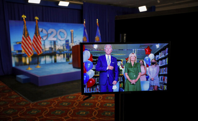 Democratic presidential candidate former Vice President Joe Biden is seen in a video feed from Delaware with his wife Jill Biden, and his grandchildren at his side, after winning the votes to become the Democratic Party's 2020 nominee for President, during the second night of the virtual 2020 Democratic National Convention in Milwaukee, Wisc., Tuesday, Aug. 18, 2020. (Brian Snyder/Pool via AP)