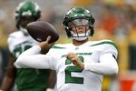 New York Jets' Zach Wilson warms up before a preseason NFL football game against the Green Bay Packers Saturday, Aug. 21, 2021, in Green Bay, Wis. (AP Photo/Matt Ludtke)