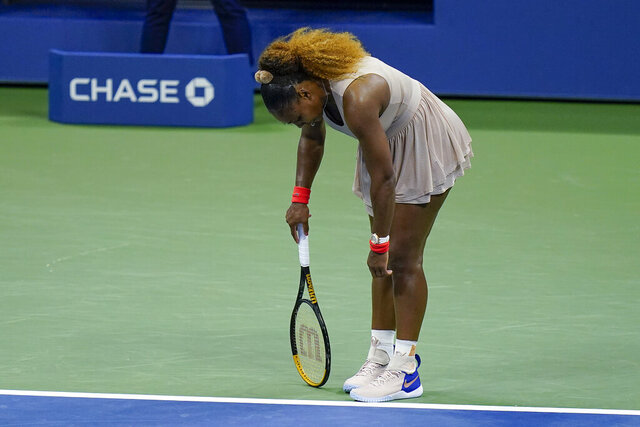 Serena Williams, of the United States, reacts during a semifinal match of the US Open tennis championships against Victoria Azarenka, of Belarus, Thursday, Sept. 10, 2020, in New York. (AP Photo/Seth Wenig)