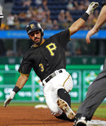 Pittsburgh Pirates' Sean Rodriguez begins his slide into third after driving in a run with a triple off Chicago White Sox starting pitcher Reynaldo Lopez during the second inning of a baseball game in Pittsburgh, Tuesday, May 15, 2018. (AP Photo/Gene J. Puskar)