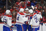 Montreal Canadiens center Jordan Weal (43) celebrates his goal with center Nate Thompson (44), center Nick Cousins (21) and defenseman Victor Mete (53) and during the second period of an NHL hockey game against the Washington Capitals, Friday, Nov. 15, 2019, in Washington. (AP Photo/Nick Wass)