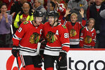 FILE - Chicago Blackhawks' Patrick Kane (88) celebrates with teammate Jonathan Toews (19) after scoring a hat trick during the third period of an NHL hockey game against the Minnesota Wild in Chicago, in this Sunday, Dec. 15, 2019, file photo. The Chicago Blackhawks are going to remain the Blackhawks — and there is no sign of any change coming anytime soon. Speaking publicly Thursday, Dec. 17, 2020, for the first time since baseball's Cleveland Indians announced Monday they plan to change their name, Blackhawks CEO Danny Wirtz reiterated the same message the team shared this summer after lingering questions about Native American team names returned to the forefront. (AP Photo/Paul Beaty, File)