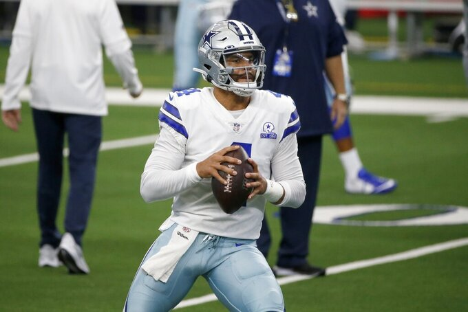 Dallas Cowboys quarterback Dak Prescott (4) warms up before an NFL football game against the Atlanta Falcons in Arlington, Texas, Sunday, Sept. 20, 2020. (AP Photo/Michael Ainsworth)