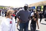 Former NBA basketball player Michael Jordan, center, visits racing teams before a NASCAR Cup Series race, Sunday, June 6, 2021, at Sonoma Raceway in Sonoma, Calif. (AP Photo/D. Ross Cameron)