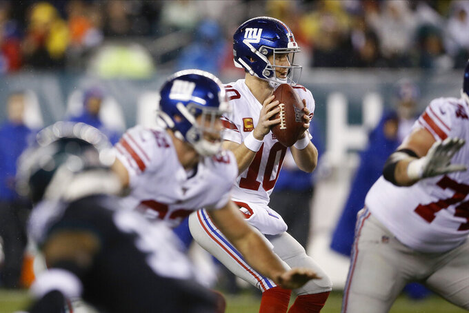 New York Giants' Eli Manning plays during the first half of an NFL football game against the Philadelphia Eagles, Monday, Dec. 9, 2019, in Philadelphia. (AP Photo/Michael Perez)