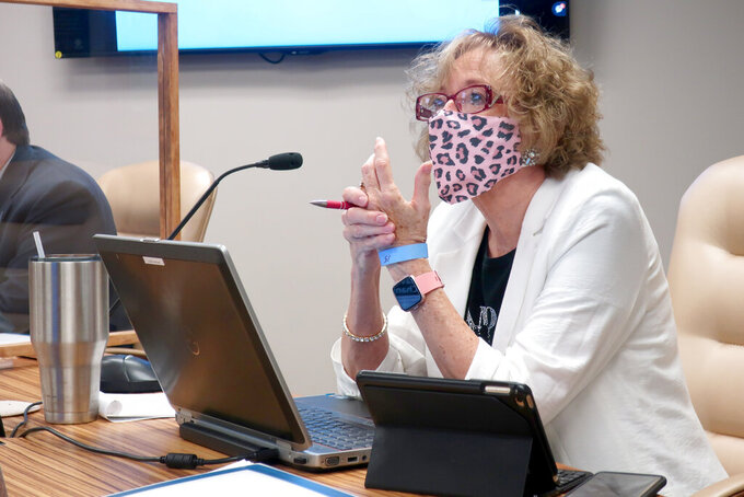 Kansas State Board of Education member Ann Mah, D-Topeka, follows a presentation on proposed guidelines for reopening the state's K-12 schools as planned during the coronavirus pandemic, Wednesday, July 15, 2020, in Topeka, Kan. The board approved the guidlines, which call for all teachers and other staff to wear masks and to undergo daily temperature checks. (AP Photo/John Hanna)
