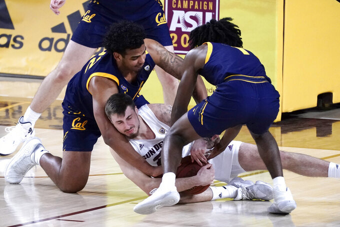 Arizona State forward Chris Osten (21) struggles for the ball with California forward Andre Kelly and guard Joel Brown (1) during the second half of an NCAA college basketball game, Thursday, Jan. 28, 2021, in Tempe, Ariz. Arizona State won 72-68. (AP Photo/Rick Scuteri)