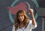 """FILE - In this Jan. 18, 2020, file photo, Caitlyn Jenner speaks at the fourth Women's March in Los Angeles. Jenner, the former Olympic champion and reality TV personality now running for California governor, said she opposes transgender girls competing in girls' sports at school. Jenner told a TMZ reporter on Saturday, May 1, 2021, that it's """"a question of fairness."""" (AP Photo/Damian Dovarganes, File)"""