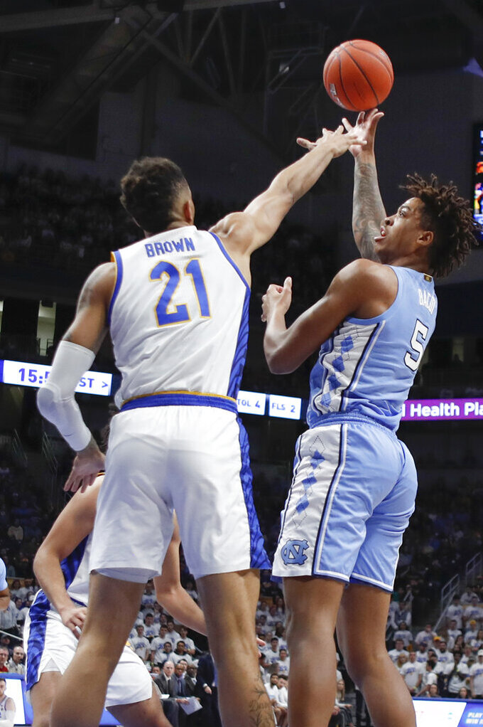 North Carolina's Armando Bacot (5) shoots over Pittsburgh's Terrell Brown (21) during the first half of an NCAA college basketball game, Saturday, Jan. 18, 2020, in Pittsburgh. (AP Photo/Keith Srakocic)