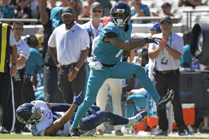 Jacksonville Jaguars wide receiver Tavon Austin, right, runs past Tennessee Titans safety Dane Cruikshank (29) after a reception during the first half of an NFL football game, Sunday, Oct. 10, 2021, in Jacksonville, Fla. (AP Photo/Phelan M. Ebenhack)