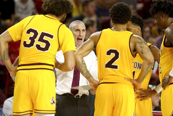 Arizona State coach Bobby Hurley talks to the team during the second half of an NCAA college basketball game against Washington on Thursday, March 5, 2020, in Tempe, Ariz. (AP Photo/Darryl Webb)