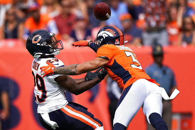 Denver Broncos free safety Justin Simmons, right, breaks up a pass intended for Chicago Bears running back Tarik Cohen (29) during the first half of an NFL football game, Sunday, Sept. 15, 2019, in Denver. (AP Photo/Jack Dempsey)