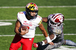 Maryland quarterback Taulia Tagovailoa (3) runs past Indiana's D.K. Bonhomme (42) during the first half of an NCAA college football game, Saturday, Nov. 28, 2020, in Bloomington, Ind. (AP Photo/Darron Cummings)