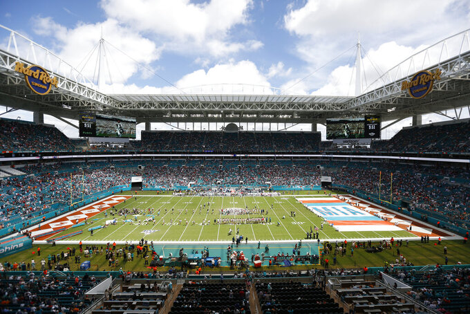FILE - In this file photo dated Sunday, Sept. 15, 2019, The Hard Rock Stadium in Miami, USA, during a pre-game ceremony before an NFL game between the Miami Dolphins and the New England Patriots.  The Spanish soccer league said Thursday Oct. 17, 2019, it has asked the Spanish soccer federation to allow Villarreal's regular season home game against Atletico Madrid on Dec. 6 to be moved to Hard Rock Stadium in Miami. (AP Photo/Brynn Anderson, FILE)