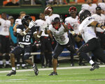Hawaii wide receiver JoJo Ward (19) makes a catch over UNLV defensive back Jocquez Kalili (26) and defensive back Evan Austrie (17) during the fourth quarter of an NCAA college football game, Saturday, Nov. 17, 2018, in Honolulu. Hawaii defeated UNLV 35-28. (AP Photo/Marco Garcia)
