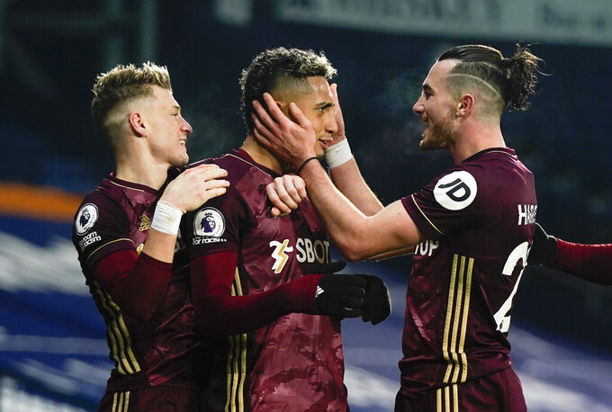 Leeds' Raphinha, center, celebrates after scoring his side's fifth goal during the English Premier League soccer match between West Bromwich Albion and Leeds United at the Hawthorns stadium, West Bromwich, England, Tuesday, Dec., 29, 2020. (Tim Keeton/Pool via AP)
