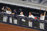 New York Yankees in the dugout react to Aaron Judge's eighth-inning, two-run home run in a baseball game against the Boston Red Sox, Sunday, Aug. 2, 2020, at Yankee Stadium in New York. (AP Photo/Kathy Willens)