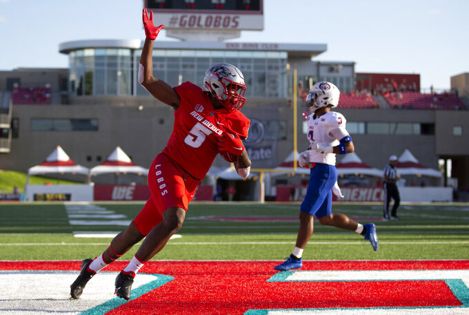 New Mexico tight end Kyle Jarvis (5) celebrates after scoring a touchdown against Houston Baptist during the first half of an NCAA college football game Thursday, Sept. 2, 2021, in Albuquerque, N.M. (AP Photo/Andres Leighton)
