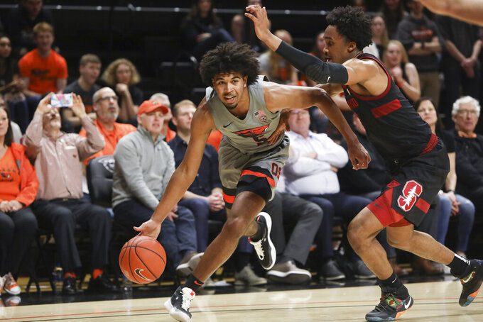 Oregon State's Ethan Thompson (5) dribbles past Stanford's Bryce Wills (2) during the first half of an NCAA college basketball game in Corvallis, Ore., Thursday, March 5, 2020. (AP Photo/Amanda Loman)