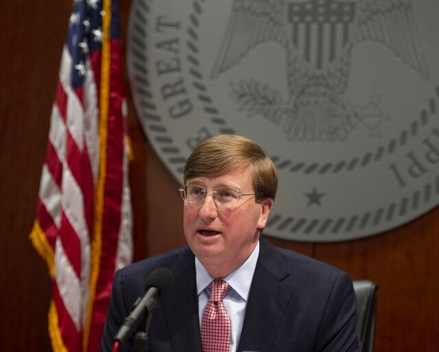 Mississippi Gov. Tate Reeves speaks during a live-streamed news conference Wednesday, April 1, 2020, in Jackson, Miss Reeves was there to sign and discuss an executive order for the state to shelter-in-place during the coronavirus outbreak. The order will go into effect starting Friday at 5 p.m. (Sarah Warnock/The Clarion-Ledger via AP)