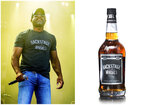 This combination photo shows singer Darius Rucker, left, and a bottle of his whiskey brand Backstage Southern Whiskey. (AP Photo, left, and Backstage Southern Whiskey via AP)