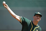 Oakland Athletics starting pitcher Chris Bassitt throws during the first inning of a baseball game against the Kansas City Royals Thursday, Aug. 29, 2019, in Kansas City, Mo. (AP Photo/Charlie Riedel)