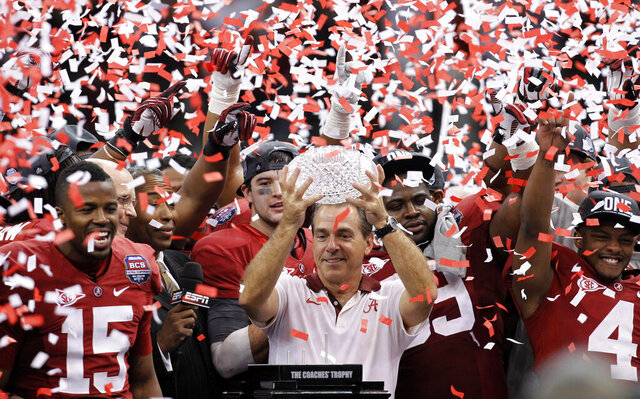 FILE - Alabama head coach Nick Saban celebrates with his team after the BCS National Championship college football game against LSU in New Orleans, in this Monday, Jan. 9, 2012, file photo, Alabama won 21-0. Saban's dominating run at Alabama is more than just wins and championships. He's also ruined the careers of many of his fellow SEC coaches and cost the league's other 13 schools more than $100 million in buyouts -- all in search of someone who can knock the game's greatest coach from his perch.(AP Photo/Gerald Herbert, File)