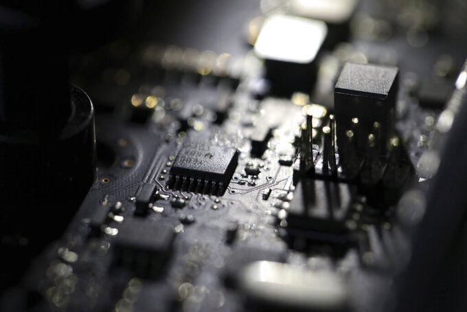 """FILE - This Feb 23, 2019, file photo shows the inside of a computer. Three former U.S. intelligence and military operatives have agreed to pay nearly $1.7 million to resolve criminal charges that they provided sophisticated hacking technology to the United Arab Emirates. A charging document in federal court in Washington accuses them of helping develop """"advanced covert hacking systems for U.A.E. government agencies."""" (AP Photo/Jenny Kane, File)"""