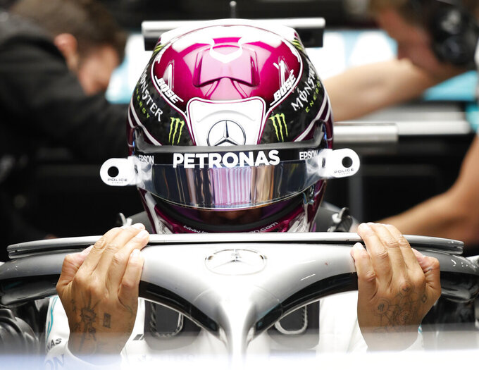 Mercedes-AMG Petronas' Lewis Hamilton prepares for a Formula One pre-season testing session at the Barcelona Catalunya racetrack in Montmelo, outside Barcelona, Spain, Wednesday, Feb. 19, 2020. (AP Photo/Joan Monfort)