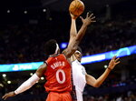 Brooklyn Nets cener Jarrett Allen (31) drives to the net as Toronto Raptors guard Terence Davis (0) goes up for the block during the first half of an NBA basketball game Saturday, Feb. 8, 2020, in Toronto. (Frank Gunn/The Canadian Press via AP)