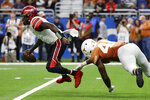 Utah quarterback Tyler Huntley (1) is pressured by Texas linebacker Joseph Ossai (46) during the second half of the Alamo Bowl NCAA college football game in San Antonio, Tuesday, Dec. 31, 2019. (AP Photo/Eric Gay)